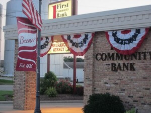 First Community Bank with corn silo in the background.