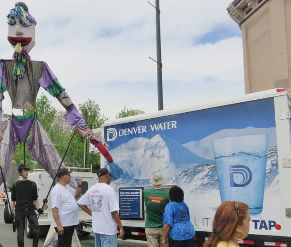 Thirsty the Giant Parade Puppet visits Denver Water for a glass of cool deliciousness!