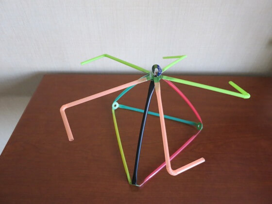 Stretch-a-Straws®  pinwheel using flexible bendy straws.<br /> Waste plastic connectors and drinking straws. Connect ordinary drinking straws into imaginative projects using die cut waste plastic and cardboard from house hold waste such as milk cartons, ice cream cartons, laundry detergent bottles, cereal boxes, soda and beer cartons.