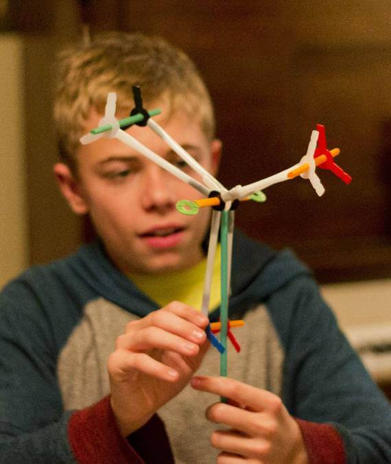 Boy assembling a Stretch-a-Straws™