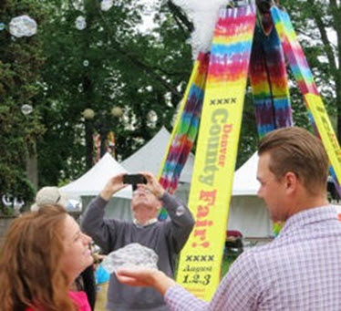 Denver County Fair co-sponsors the Bubble Tower at the Peoples Fair as part of their marketing program.