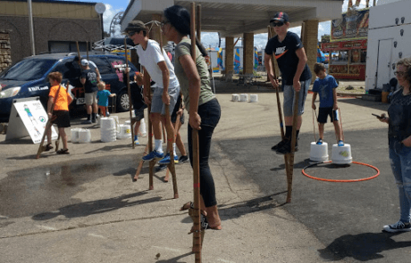 Stilt walking learners at the Dubuque County Fair